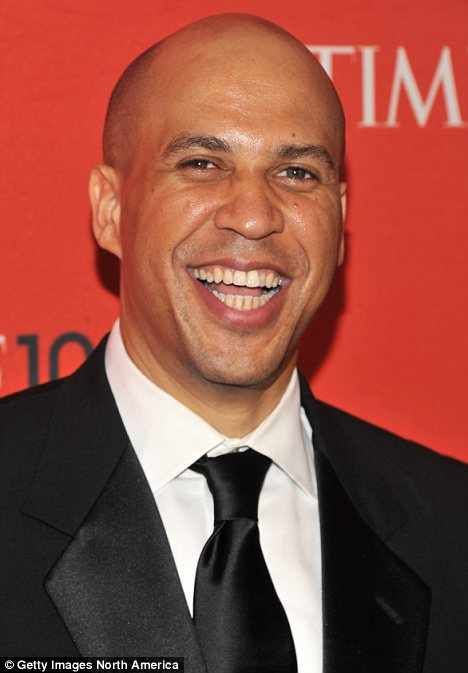 Description: Manscaping: Newark mayor Cory Booker (above) has admitted that he sneaks out of his home to get midnight manicures and pedicures